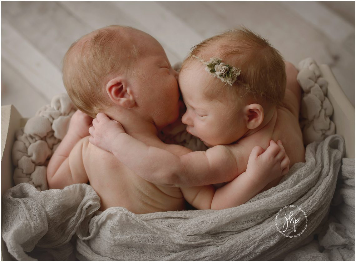Sweet twin newborns session posing